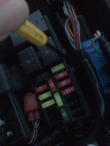 on the back of the fusebox, there is a small latch holding the box in  place  you may now insert your screwdriver/pick and unlatch the box   lift  the fusebox